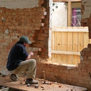 Matt cleaning around the window opening.